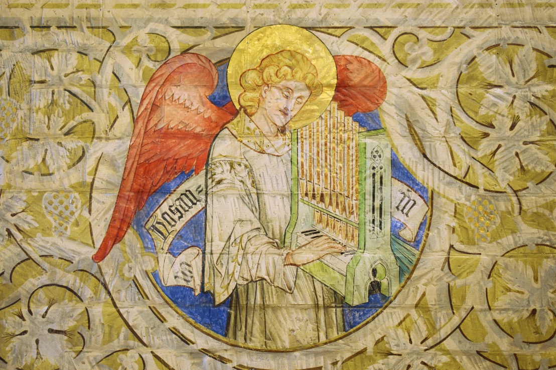 Mural image of an angel playing a musical instrument